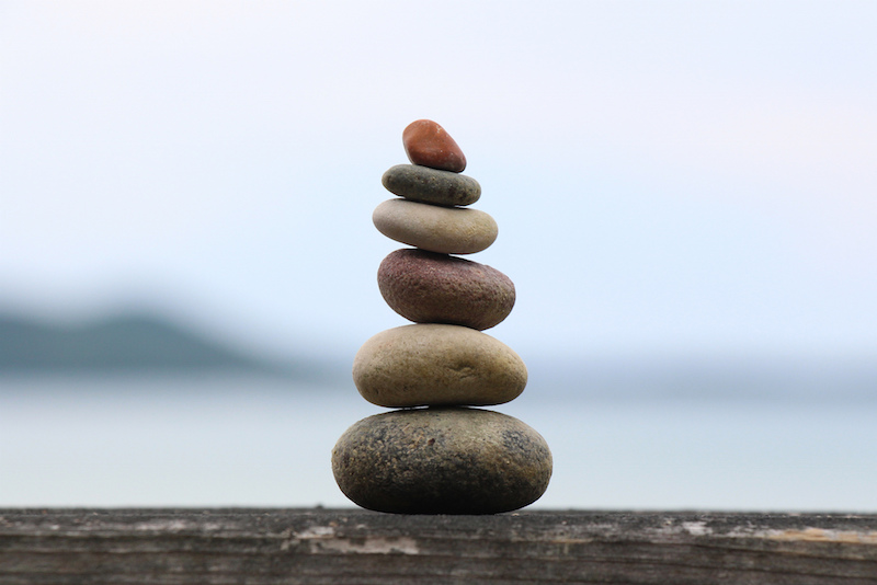 (CC BY) Flickr – woodleywonderworks – finding balance: a photograph of stones piled on top of each other in perfect balance