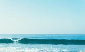 One small wave, calm sea, blue sky