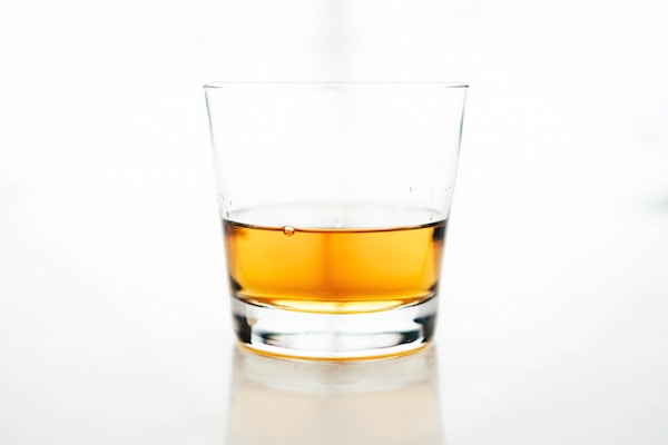 Whisky glass on white background
